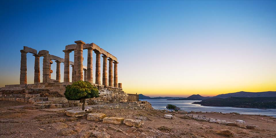 Solnedgang over Poseidons tempelruin.