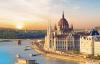 Solnedgang bag Parliamentet og Donau.